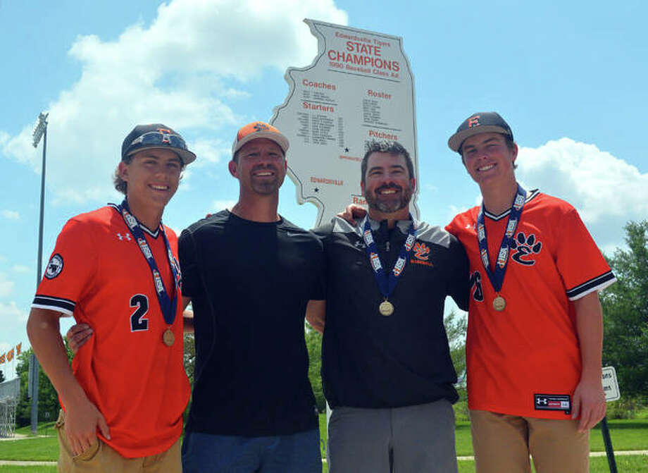 Weston Slemmer, left, is a junior on the Edwardsville baseball team, which won the Class 4A state championship on Saturday with a 3-2 victory over St. Charles North, while his father, Dave Slemmer, second from left, helped EHS win the Class AA state title in 1990. EHS coach Tim Funkhouser, second from right, also played on the 1990 team while his son, Evan Funkhouser, was a sophomore on this year's team.