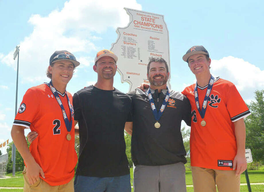 Weston Slemmer, left, is a junior on the Edwardsville baseball team, which won the Class 4A state championship on Saturday with a 3-2 victory over St. Charles North, while his father, Dave Slemmer, second from left, helped EHS win the Class AA state title in 1990. EHS coach Tim Funkhouser, second from right, also played on the 1990 team while his son, Evan Funkhouser, was a sophomore on this year's team. Photo: Scott Marion | For The Telegraph