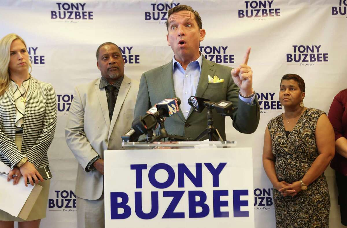 Leonard Wiggins ( second from left ) and his wife, Rhonda (right) stand by Mayoral candidate Tony Buzbee as he held a press conference to allege that some firms who received contracts from the city to renovate homes and apartments damaged by Hurricane Harvey did not use minority, women and small business subcontractors Tuesday, May 7, 2019, in Houston.