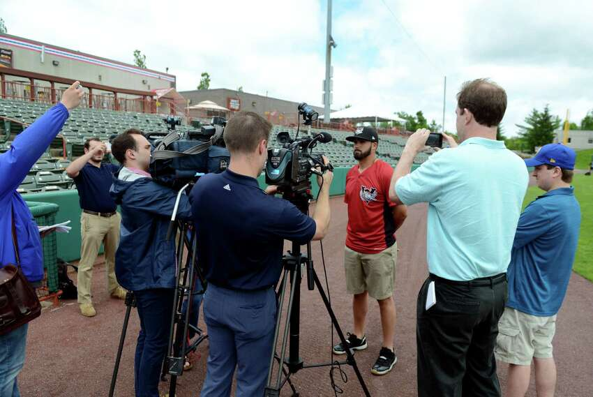 New ValleyCats manager, Ozney Guillen, center right, meets the media outside the ValleyCats dugout on Tuesday, June 11, 2019, at Joseph L. Bruno Stadium in Troy, N.Y. (Catherine Rafferty/Times Union)