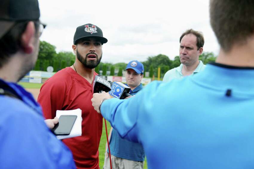 New ValleyCats manager, Ozney Guillen, center left, meets the media outside the ValleyCats dugout on Tuesday, June 11, 2019, at Joseph L. Bruno Stadium in Troy, N.Y. (Catherine Rafferty/Times Union)