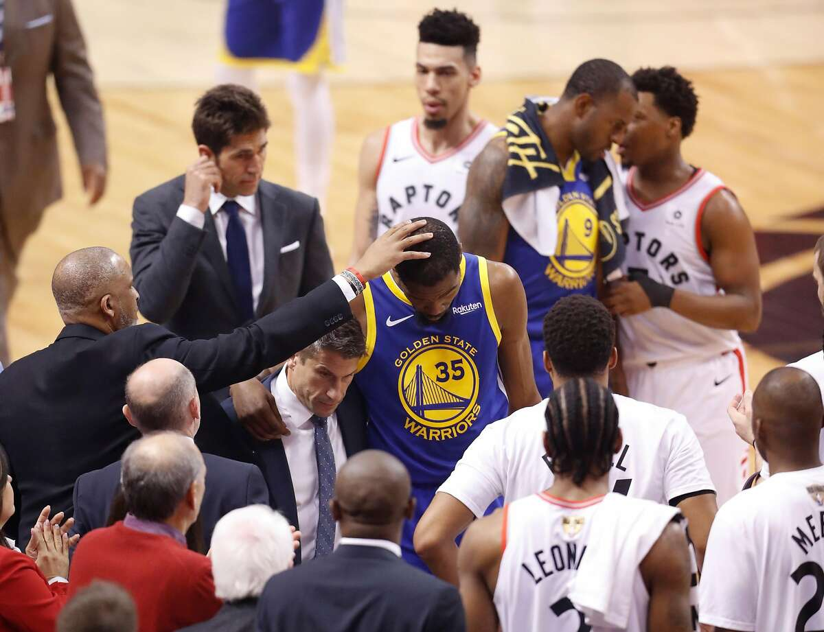 Golden State Warriors' Kevin Durant leaves the game in the second quarter during game 5 of the NBA Finals between the Golden State Warriors and the Toronto Raptors at Scotiabank Arena on Monday, June 10, 2019 in Toronto, Ontario, Canada.