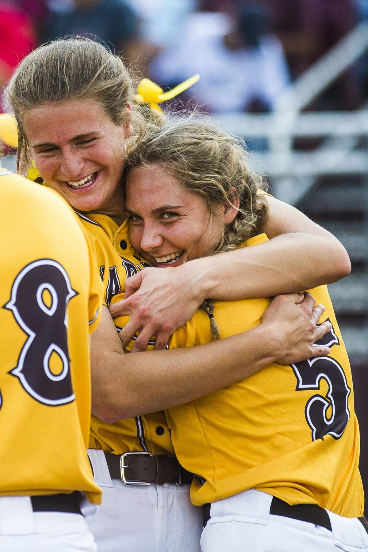 Bay City Western players celebrate after their Division 1 state quarterfinals victory over Lowell on Tuesday, June 11, 2019 at Central Michigan University. (Katy Kildee/kkildee@mdn.net)