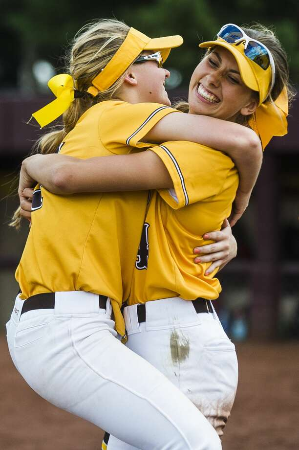 Bay City Western players celebrate after their Division 1 state quarterfinals victory over Lowell on Tuesday, June 11, 2019 at Central Michigan University. (Katy Kildee/kkildee@mdn.net) Photo: (Katy Kildee/kkildee@mdn.net)