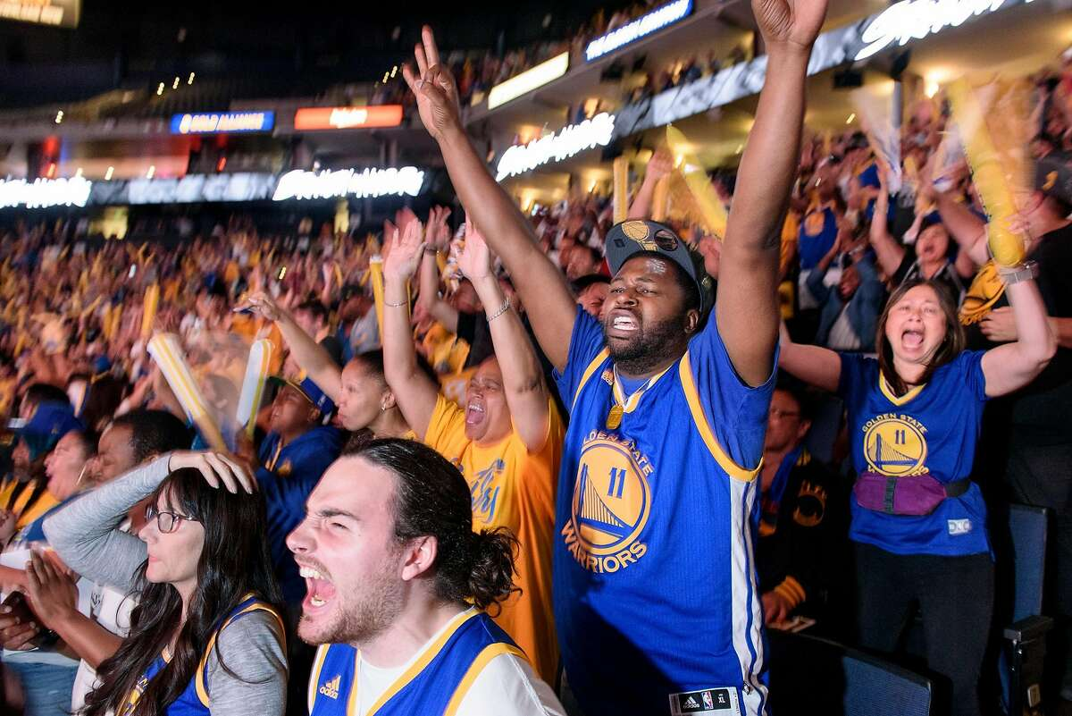 Fans cheer during the 4th quarter while attending a watch party for Game 5 of basketball's NBA Finals between the Golden State Warriors and the Toronto Raptors at Oracle Arena in Oakland, Calif., on Monday, June 10, 2019.