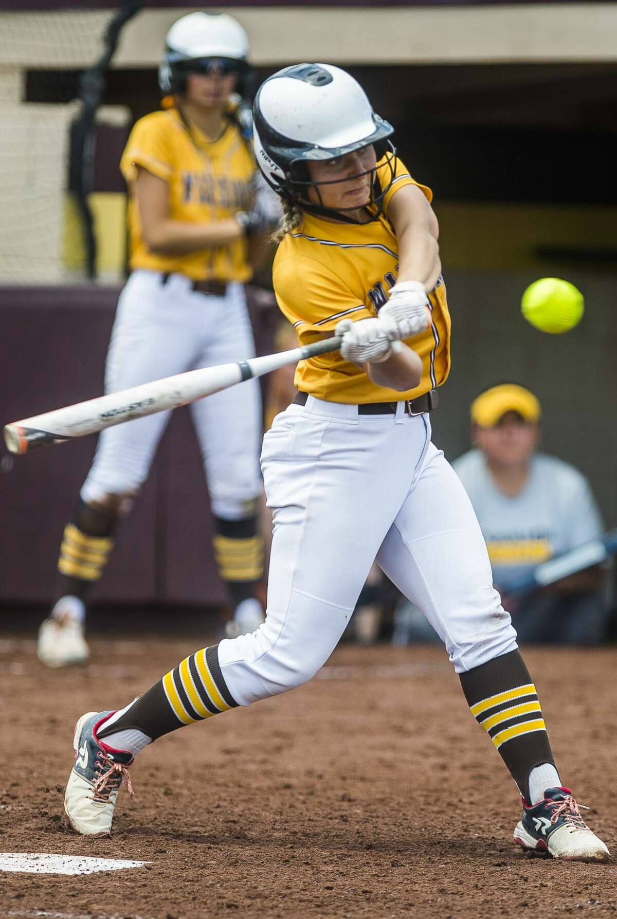 Bay City Western's Katie Bickham swings on a pitch during the Warriors' Division 1 state quarterfinals victory over Lowell on Tuesday, June 11, 2019 at Central Michigan University. (Katy Kildee/kkildee@mdn.net)