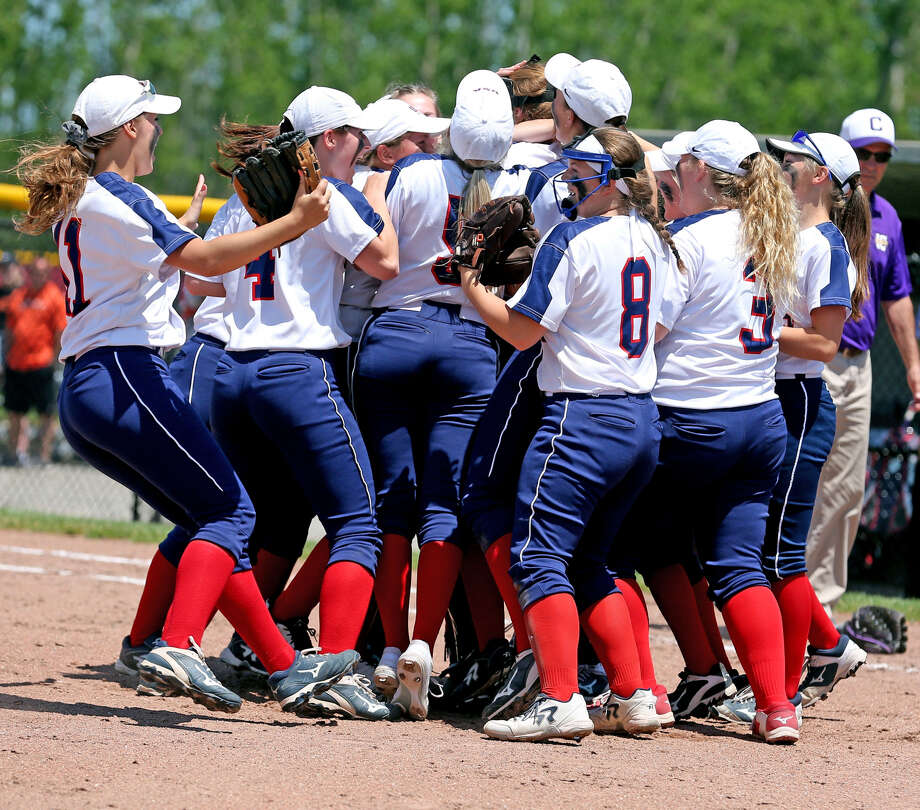 The USA softball team celebrates following its 13-0 Division 4 quarterfinal victory over Allen Park Inter-City Baptist, Tuesday, at Saginaw Valley State University. Photo: Paul P. Adams/Huron Daily Tribune