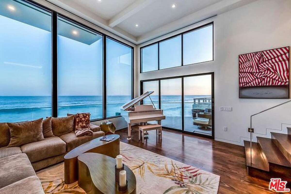 Living room with floor-to-ceiling windows.