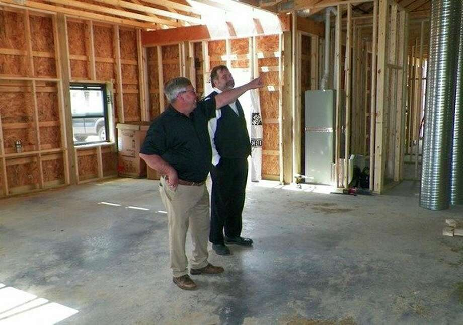 Back when Mike Green was a state senator, he helped the fair board secure a $250,000 grant for a new facility at the Tuscola County Fairgrounds in Caro. Left, Green explains the layout of the building to Tuscola County Economic Development Corporation Director Steve Erickson. (Courtesy Photo)