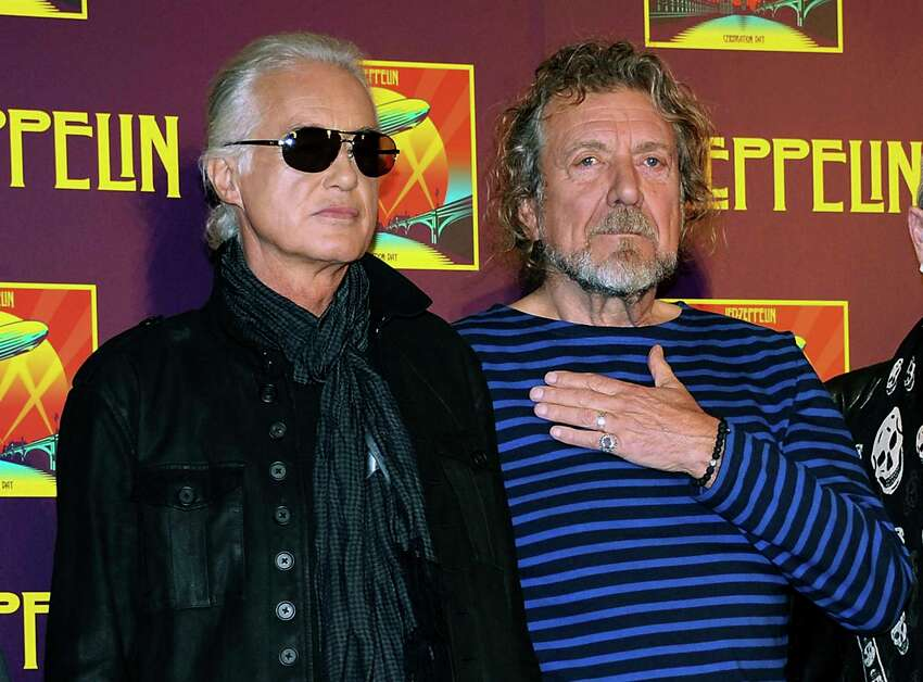 FILE - In this Oct. 9, 2012 file photo, Led Zeppelin guitarist Jimmy Page, left, and singer Robert Plant appear at a news conference ahead of the worldwide theatrical release of