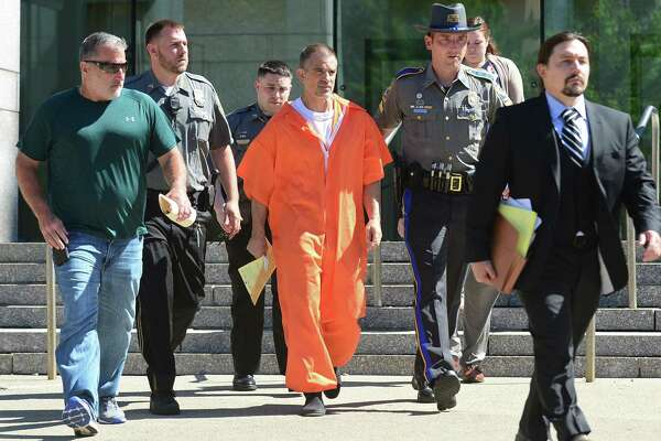 Mark Motuzick, left, of Capitol Bail Bonds, walks out of state Superior Court in Stamford with Fotis Dulos after posting his first $500,000 bond last June.