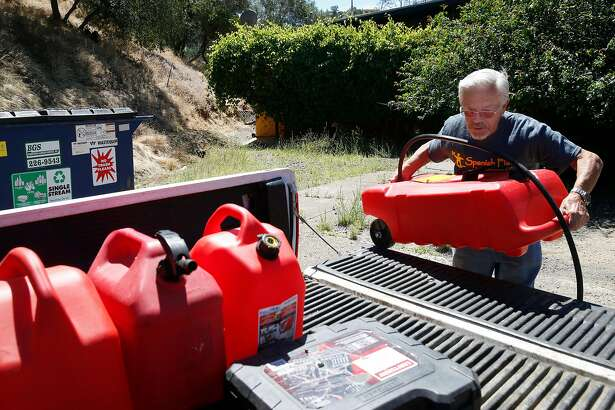 Jerry Rehmke collects empty gas cans to take to refill for the gas generator behind the Spanish Flat Country Store and Deli in Lake Berryessa, Calif. on Saturday, June 8, 2019. PG&E enabled its public power safety shutoff protocol resulting in outages for 1,600 customers in the area.