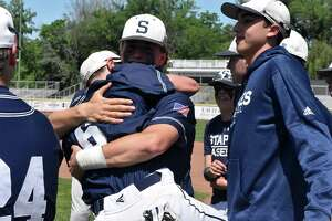 Staples players celebrate after winning the Class LL state championship game over Southington on Saturday.
