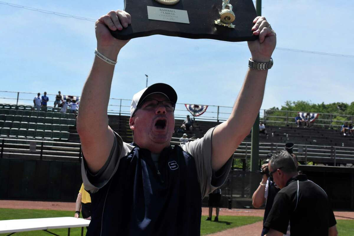 Staples coach Jack McFarland celebrates after the Wreckers defeated Southington in the Class LL state championship game Saturday.