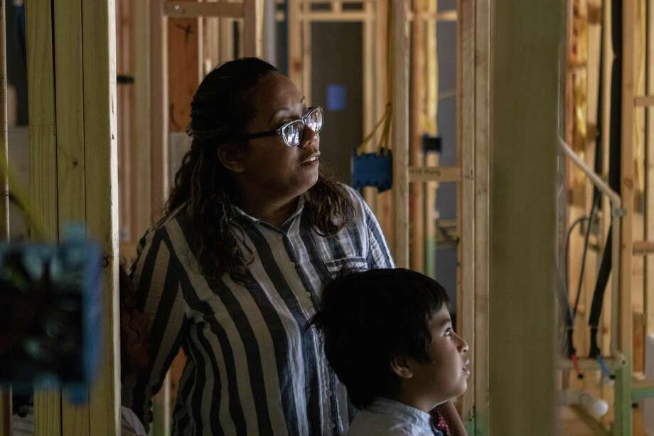Anne Sengstock and her son Roland Sengstock III, 8, walk through the framing of their future home Tuesday, June 11, 2019 at The Woodlands Hills in Willis. Photo: Cody Bahn, Houston Chronicle / Staff Photographer / © 2018 Houston Chronicle