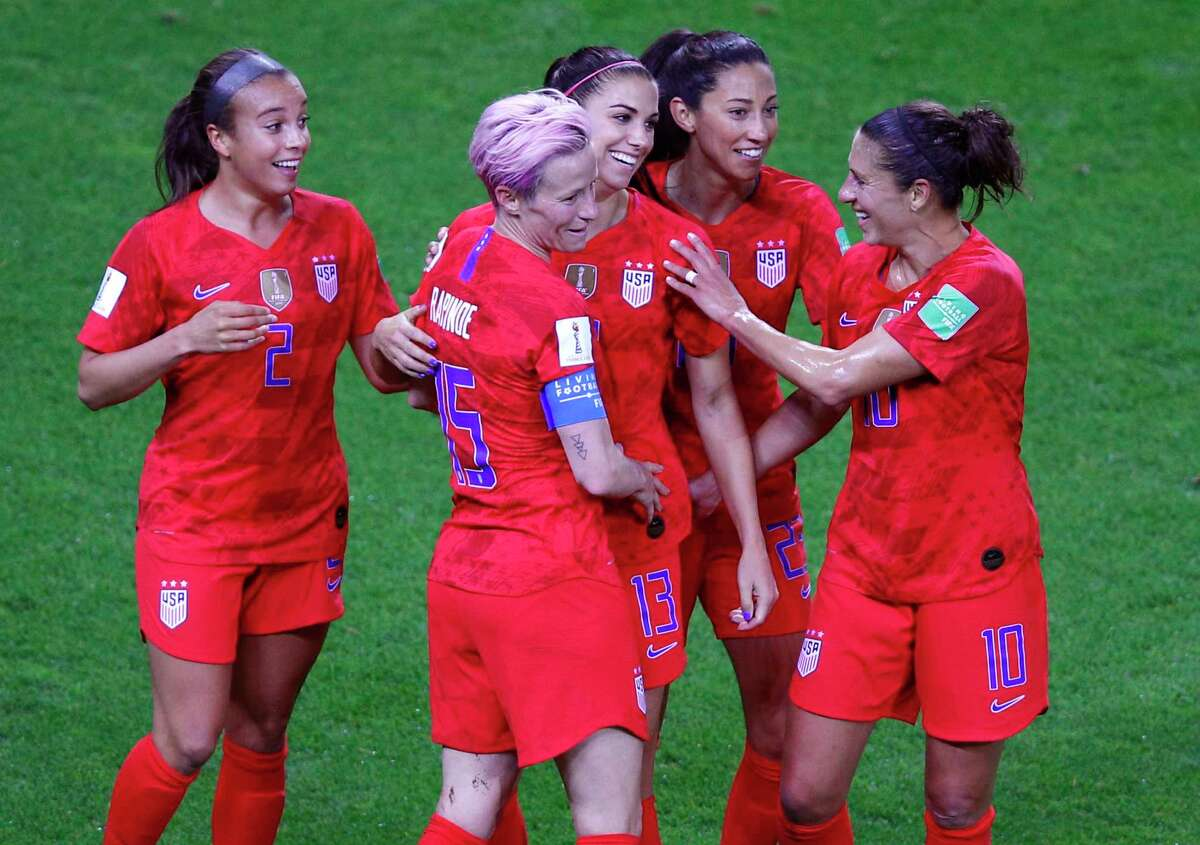 United States' Alex Morgan, centre, is congratulated by teammates after scoring her fifth goal during the Women's World Cup Group F soccer match between the United States and Thailand at the Stade Auguste-Delaune in Reims, France, Tuesday, June 11, 2019. (AP Photo/Francois Mori)