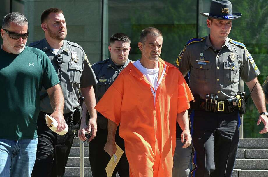 Fotis Dulos exits Stamford Superior Court with bondsman, state police and judicial marshals after posting $500,000 bond for charges of tampering with evidence and hindering the investigation into the disappearance of his wife, Jennifer Dulos, Tuesday, June 11, 2019 in Stamford, Conn. Photo: Erik Trautmann / Hearst Connecticut Media / Norwalk Hour