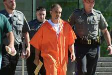Fotis Dulos exits state Superior Court on June 11 with a bondsman, state police and judicial marshals after posting $500,000 bond on charges of tampering with evidence and hindering the investigation into the disappearance of his wife, Jennifer Dulos.