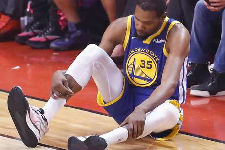 Golden State Warriors' Kevin Durant checks his right leg in the second quarter during game 5 of the NBA Finals between the Golden State Warriors and the Toronto Raptors at Scotiabank Arena on Monday, June 10, 2019 in Toronto, Ontario, Canada.