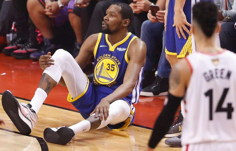 Golden State Warriors' Kevin Durant sits on the floor after sustaining an injury to his right leg in the second quarter during game 5 of the NBA Finals between the Golden State Warriors and the Toronto Raptors at Scotiabank Arena on Monday, June 10, 2019 in Toronto. Photo: Scott Strazzante, The Chronicle