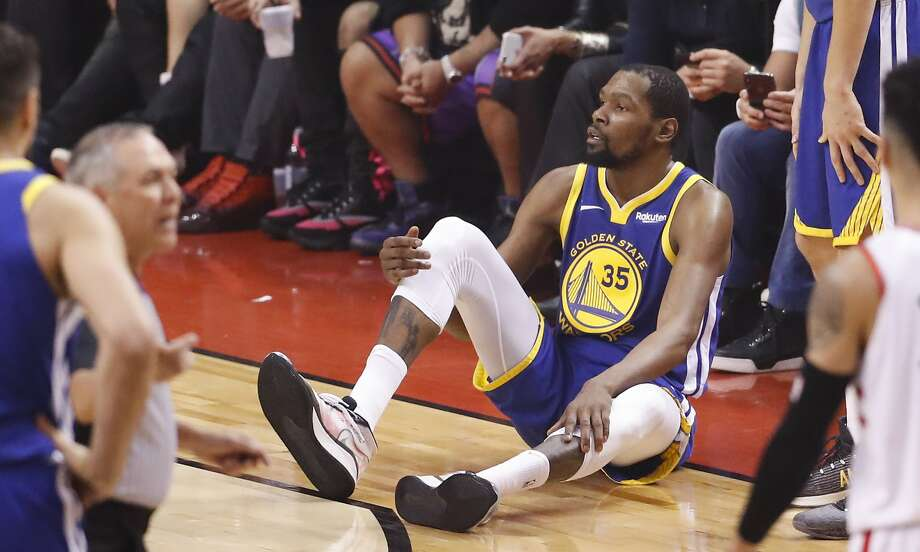 Golden State Warriors' Kevin Durant sits on the floor after sustaining an injury to his right leg in the second quarter during game 5 of the NBA Finals between the Golden State Warriors and the Toronto Raptors at Scotiabank Arena on Monday, June 10, 2019 in Toronto, Ontario, Canada. Photo: Scott Strazzante, The Chronicle