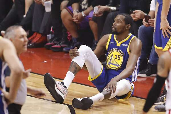 0cd5bbd3 1of10Golden State Warriors' Kevin Durant sits on the floor after sustaining  an injury to his right leg in the second quarter during game 5 of the NBA  Finals ...