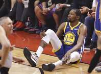 Golden State Warriors' Kevin Durant sits on the floor after sustaining an injury to his right leg in the second quarter during game 5 of the NBA Finals between the Golden State Warriors and the Toronto Raptors at Scotiabank Arena on Monday, June 10, 2019 in Toronto, Ontario, Canada.