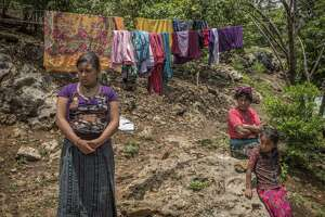 Flor Micaela Jorge Santizo, whose husband has left to find work in Mexico outside her home in Nenton, a village in Guatemala's western highlands May 28. She noted that drought and unprecedented winds have destroyed successive corn crops, leaving the family destitute.