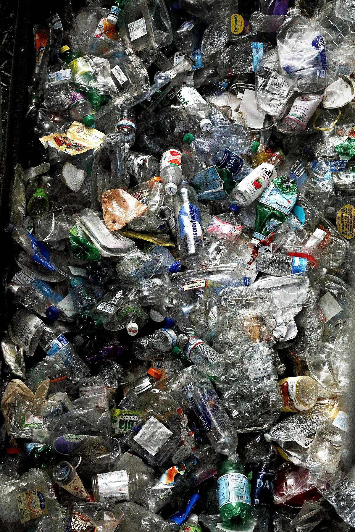 Plastic bottles ready to be turned into bales are seen in a high density baler at Recology�s Recycle Central on Tuesday, June 11, 2019 in San Francisco, Calif.