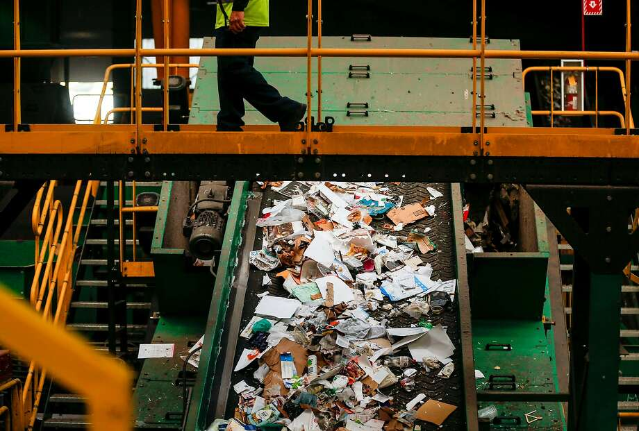 A man who accidentally tossed $23,000 into the recycling bin reunited with his life savings Saturday after a worker at a recycling facility in Northern California spotted a shoebox stuffed with money. Photo: A worker walks above a conveyer belt of plastics and paper at Recology's Recycle Central on Tuesday June 11, 2019 in San Fransisco, Calif. Photo: Josie Norris / The Chronicle