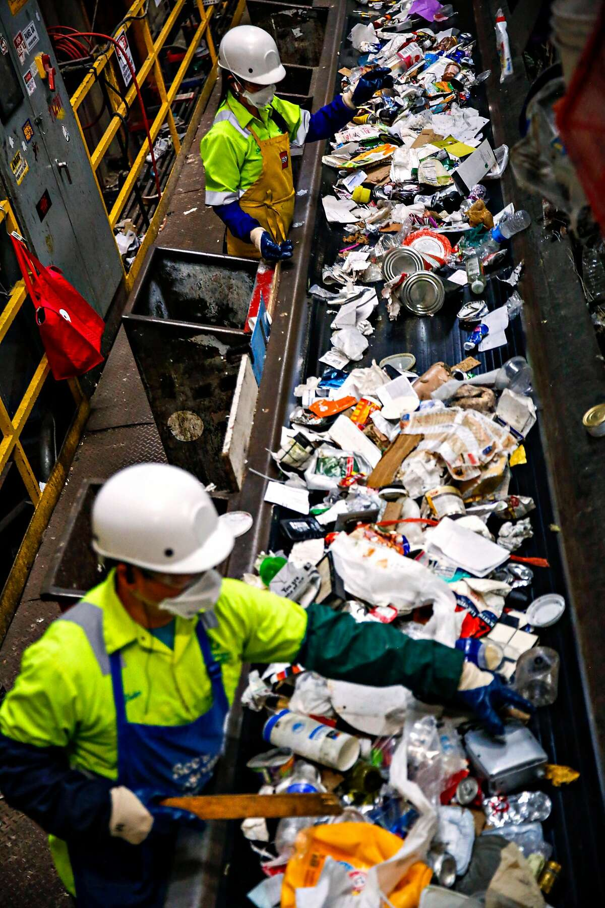 Sorters on the container line separate refuse by material for recycling at Recology's Recycle Central on Tuesday June 11, 2019 in San Fransisco, Calif.