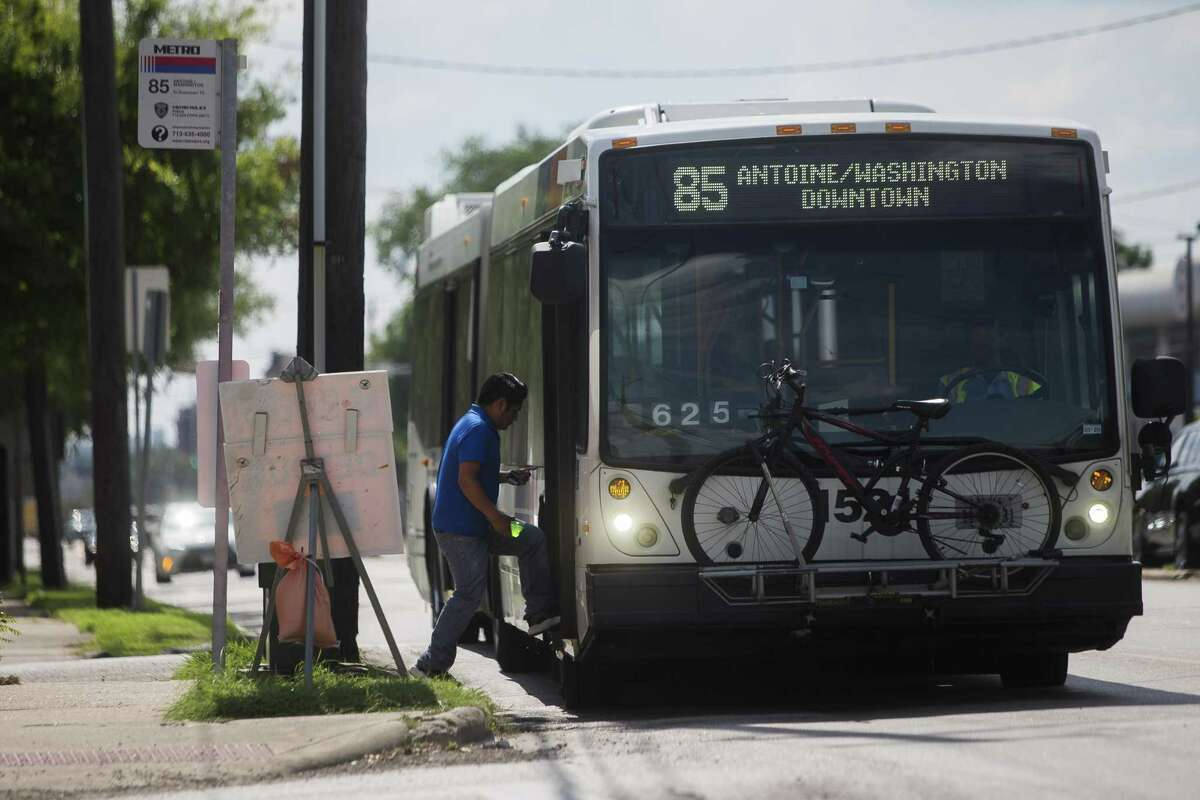 A commuter boards a Metro Route 85 bus at the intersection of Washington Avenue and Studemont in Houston, Monday, June 10, 2019.