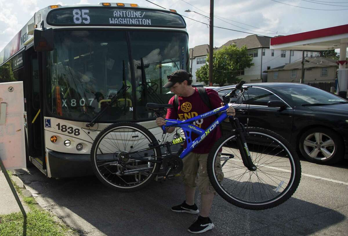 A commuter disembarks a Metro Route 85 bus at the intersection of Washington Avenue and Studemont in Houston, Monday, June 10, 2019.