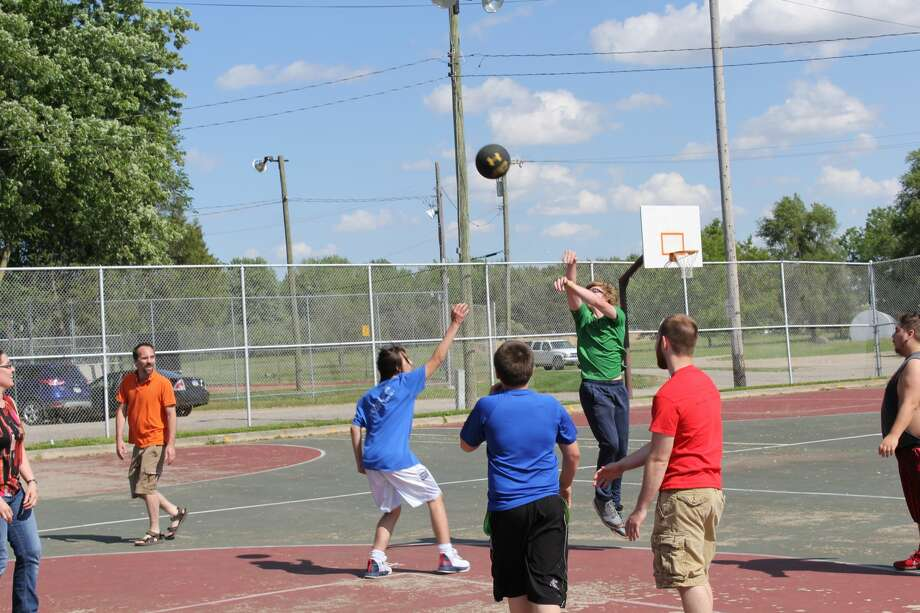 The Huron County Families Against Narcotics chapter hosted a basketball game and barbecue at Bad Axe City Park on Tuesday. FAN speakers spoke about the group's mission after the game. Photo: Robert Creenan/Huron Daily Tribune