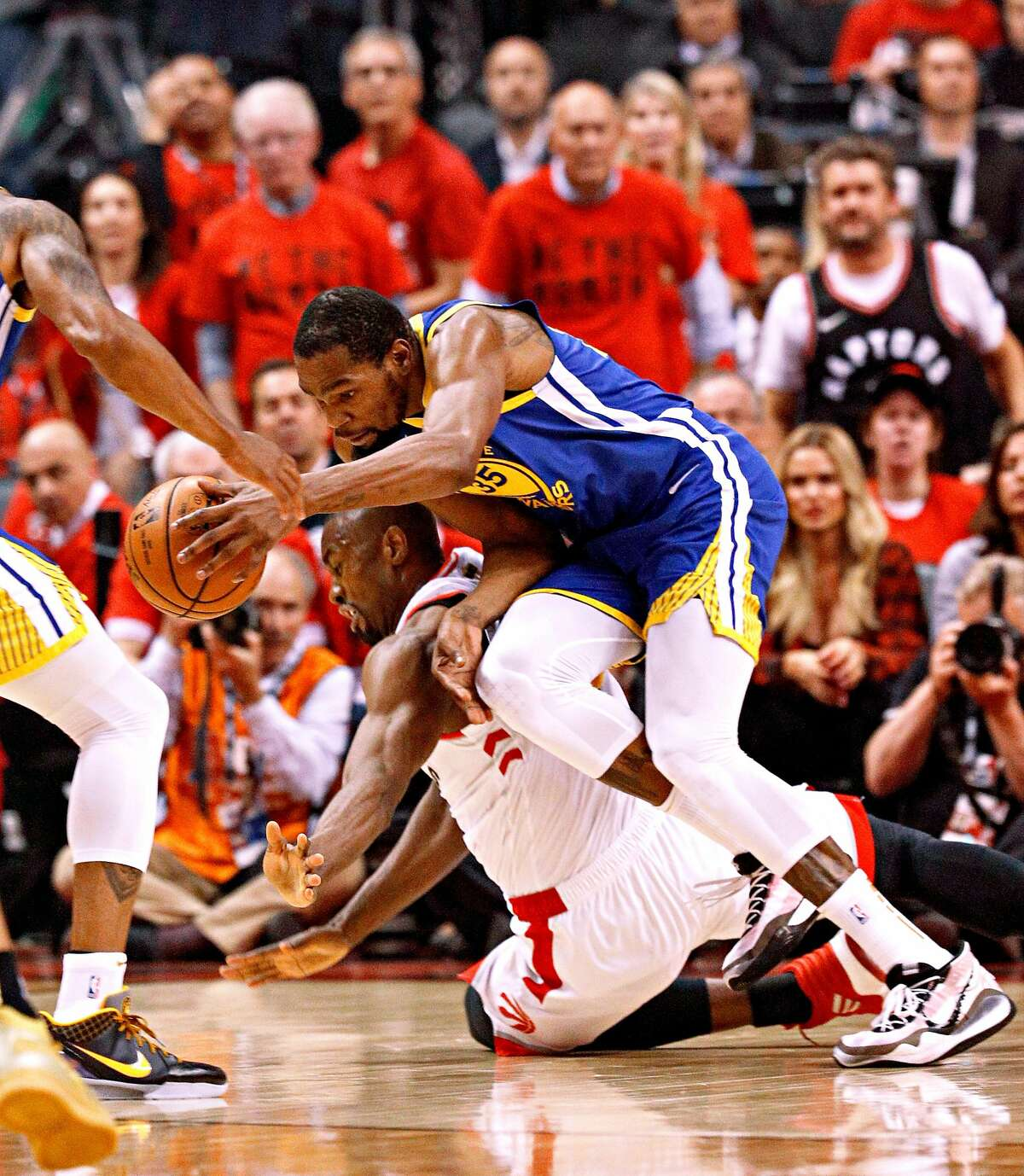 Golden State Warriors� Kevin Durant gets tripped up on Toronto Raptors� Serge Ibaka in the first quarter during game 5 of the NBA Finals between the Golden State Warriors and the Toronto Raptors at Scotiabank Arena on Monday, June 10, 2019 in Toronto, Ontario, Canada.