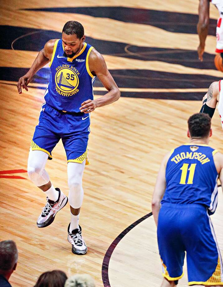 Golden State Warriors' Kevin Durant limps away from the play in the second quarter during game 5 of the NBA Finals between the Golden State Warriors and the Toronto Raptors at Scotiabank Arena on Monday, June 10, 2019 in Toronto, Ontario, Canada. Photo: Carlos Avila Gonzalez, The Chronicle