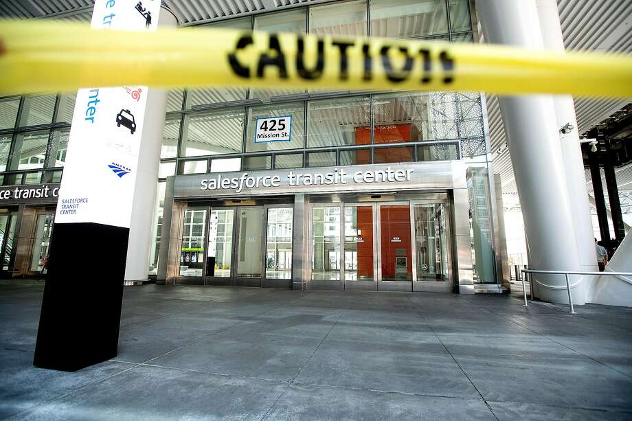 Caution tape blocks an entrance to the Salesforce Transit Center in April during work to repair cracked support girders. The Transbay transit center is set to reopen July 1, first with its rooftop park. Photo: Noah Berger / Special To The Chronicle