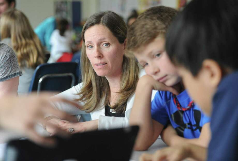 Fourth-grade teacher Crystal Kitselman observes as her students use an iPad for a math project at North Mianus School in Greenwich, Conn. Wednesday, April 1, 2015. Photo: File / Tyler Sizemore / Tyler Sizemore / Greenwich Time
