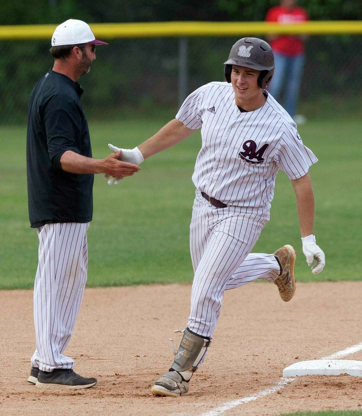 Cole Ketzner #19 of Magnolia reacts after hitting a three-run home run off Tomball starting pitcher Mason Marriott in the second inning of Game 2 during a Region III-5A bi-district high school baseball playoff series at Tomball High School, Thursday, May 2, 2019, in Tomball.