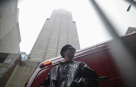 A policeman stands in front of the building where a helicopter crash-landed on top in midtown Manhattan in New York on June 10, 2019.