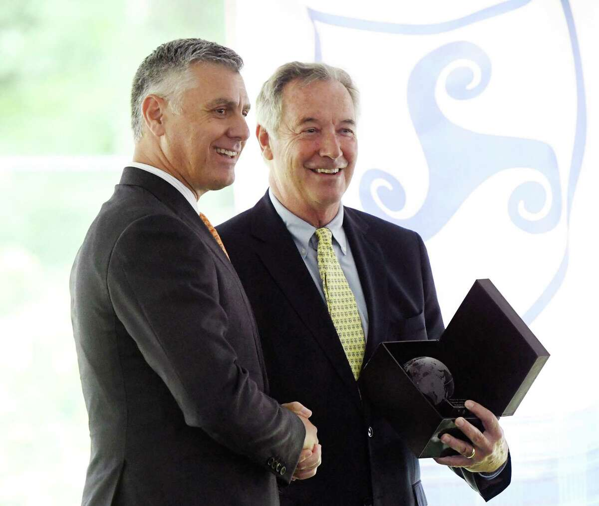 Greenwich Country Day Head of School Adam Rohdie, left, is presented with a gift from Stanwich Head of School Charles Sachs at the 2018-2019 Closing Ceremony at Stanwich School in Greenwich, Conn. Tuesday, June 11, 2019. The ceremony urged students not to forget the lessons they've learned at Stanwich, as the school will merge with Greenwich Country Day School next year.