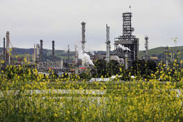 The Shell refinery in Martinez, Calif., as seen in this file photo on Wed. April 18, 2018. Shell is selling the refinery to PBF Energy in a deal expected to close this year.