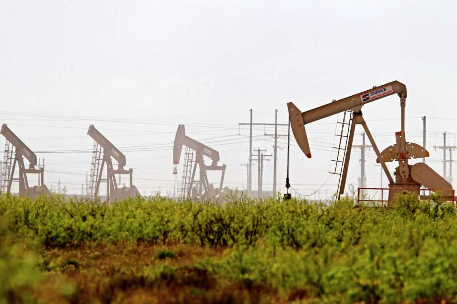 Pumpjacks operate near a Diamondback oil and gas operation in Midland County, Texas. Photo: James Durbin, MBR / Associated Press / © 2019 All Rights Reserved