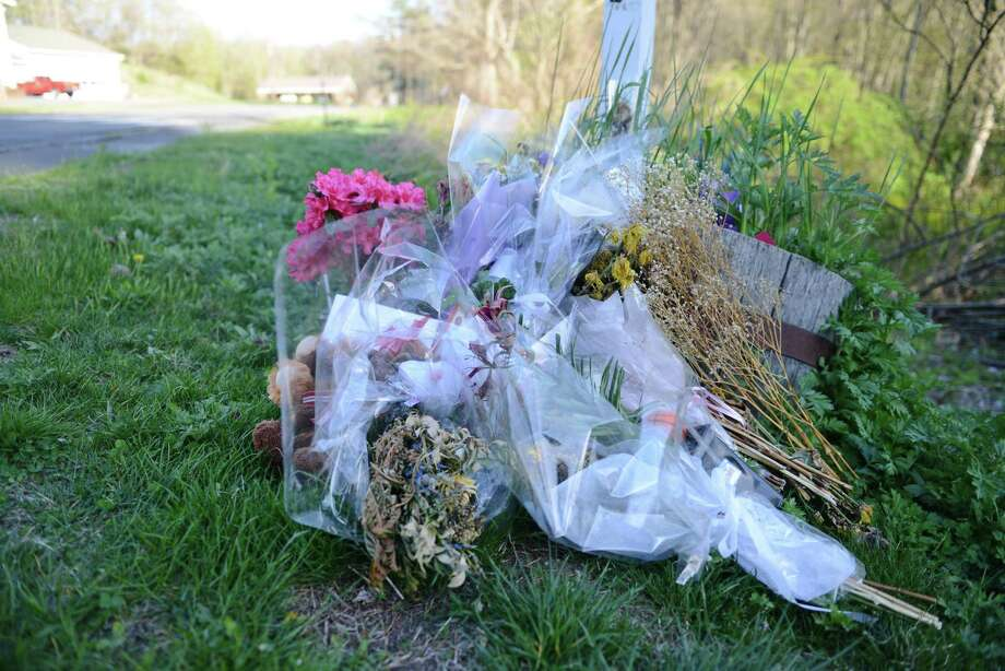 Flowers and other gifts lie outside Sandy Hook Elementary School after the 2012 shooting that killed 20 children and six adults. Efforts are under way in Congress to hold gun makers responsible for violence connected to their products. Photo: Tyler Sizemore / Tyler Sizemore / The News-Times