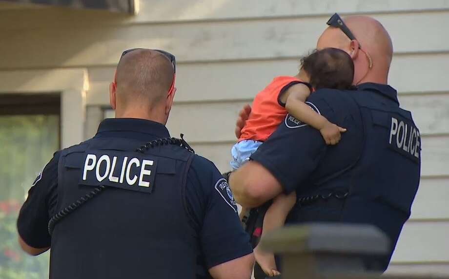 A 14-month-old boy is being held by a Renton Police officer after the boy's mother was killed in what police are calling a domestic violence incident. Photo: KOMO News Photo