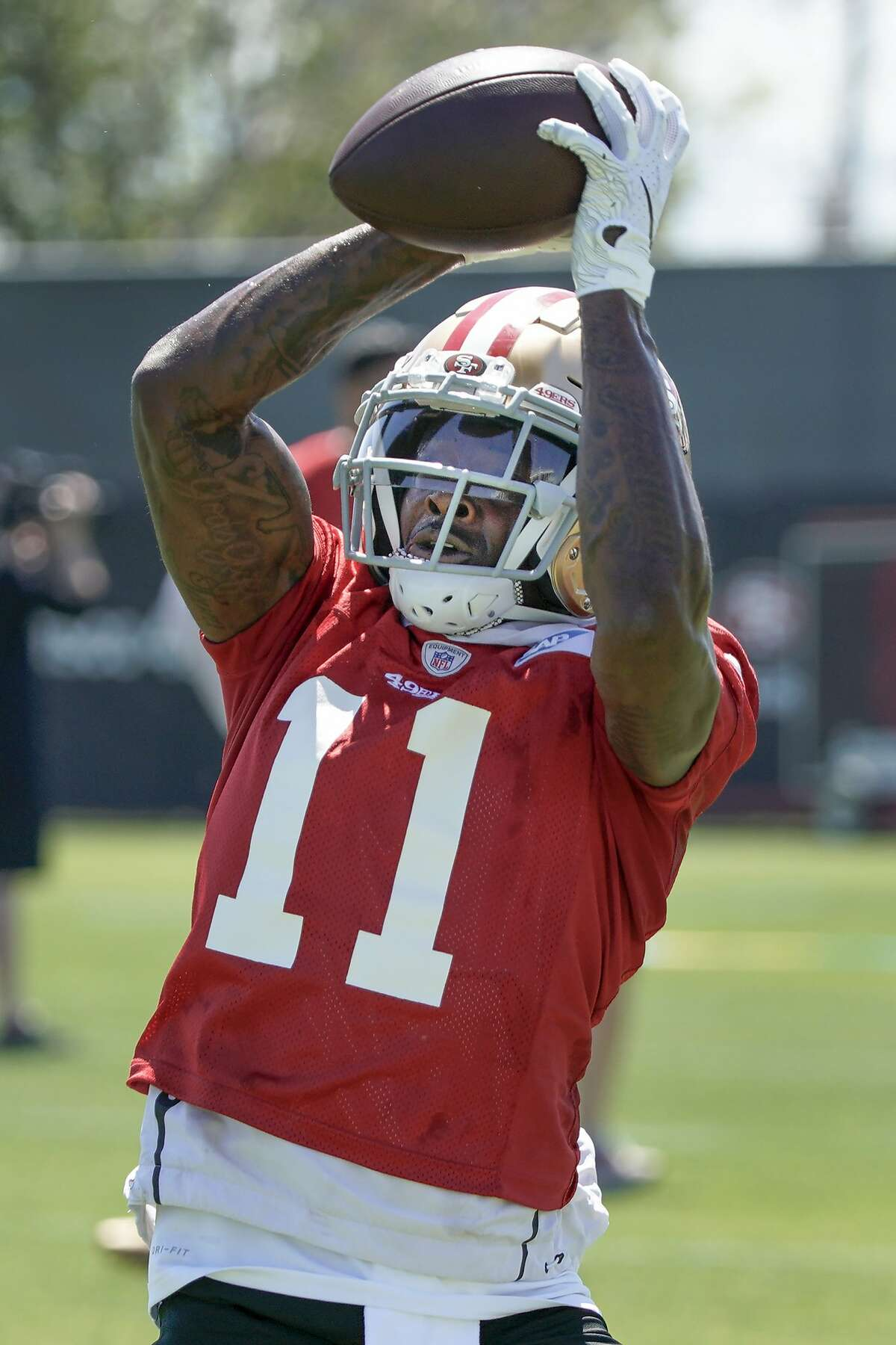 San Francisco 49ers wide receiver Marquise Goodwin (11) catches a pass during a drill at the team's NFL football training facility in Santa Clara, Calif., Tuesday, June 10, 2019. (AP Photo/Tony Avelar)