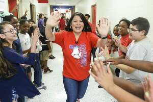 Caldwood Elementary Principle Julie Corona high fives students Thursday in the halls of the school on their last day before summer vacation. Photo taken on Wednesday, 05/22/19. Ryan Welch/The Enterprise