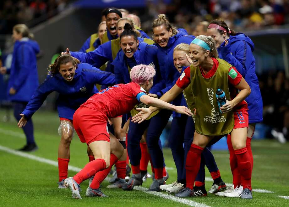 REIMS, FRANCE - JUNE 11: Megan Rapinoe of the USA celebrates with teammates after scoring her team's ninth goal during the 2019 FIFA Women's World Cup France group F match between USA and Thailand at Stade Auguste Delaune on June 11, 2019 in Reims, France. (Photo by Robert Cianflone/Getty Images) Photo: Robert Cianflone / Getty Images