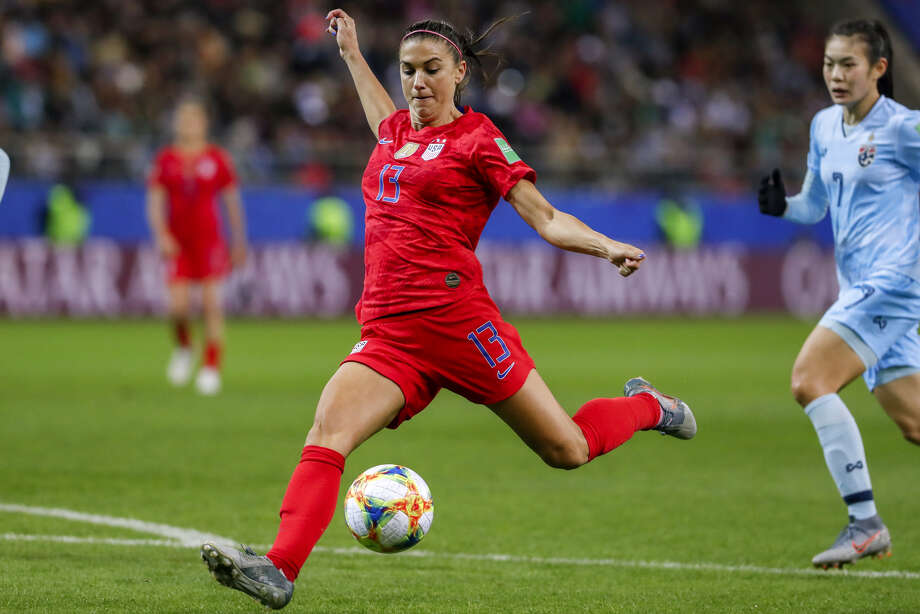 REIMS, FRANCE - JUNE 11: Alex Morgan #13 of USA scores her fifth goal, record tie, during the 2019 FIFA Women's World Cup France group F match between USA and Thailand at Stade Auguste Delaune on June 11, 2019 in Reims, France. Photo: Catherine Steenkeste / Getty Images