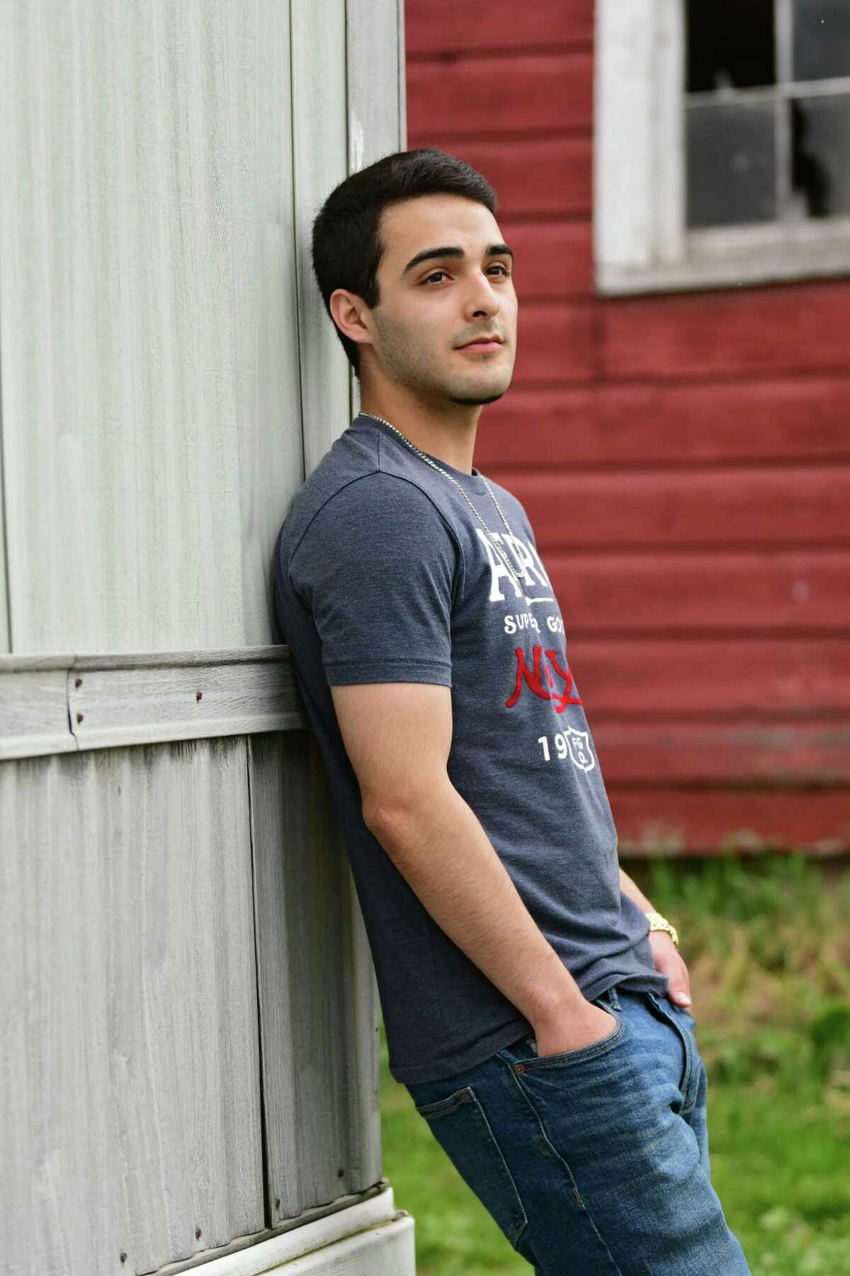 Jax stands outside his home on Monday, June 10, 2019 in Saratoga County. The Saratoga Immigration Coalition is launching a new program for assisting DACA and first-generation students in obtaining the counseling and financial support they need to apply for and/or stay in college. (Lori Van Buren/Times Union)